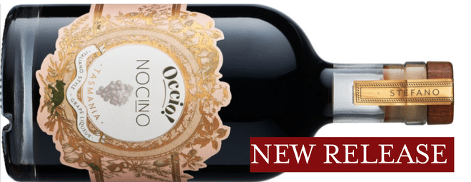 A bottle of nocino displayed on its side. The gold label reads 'Occio! Nocino' and the words 'New release' appear alongside the bottle.